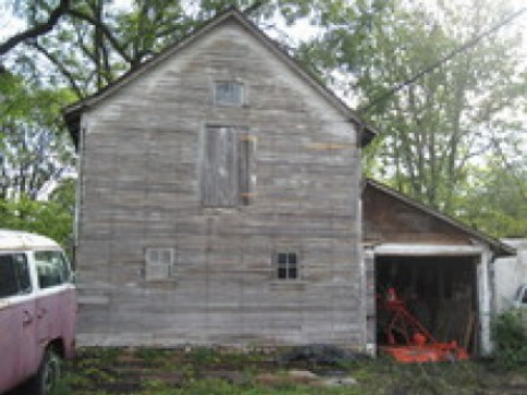 This is an old house that still stands on our property.  It was built in the late 1800's and is currently used as storage.